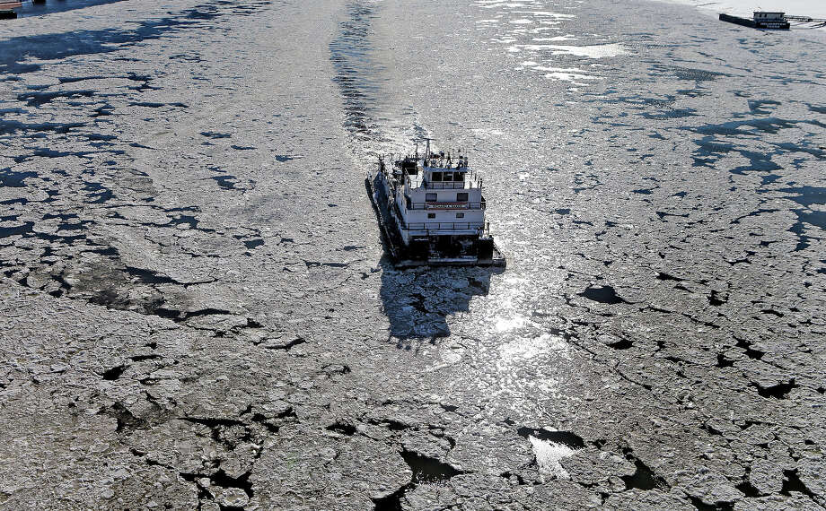 A tugboat makes its way up the icy waters of the Mississippi River on Tuesday, Jan. 7, 2014, in St. Louis. Tuesday was the worst cold snap in nearly two decades for Missouri. Photo: Laurie Skrivan, ASSOCIATED PRESS / AP2014