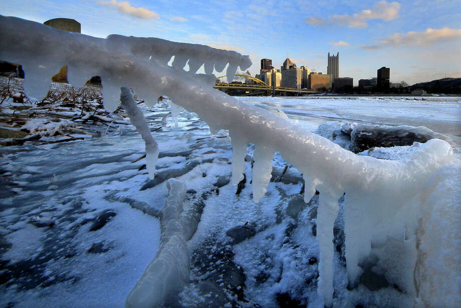 The skyline of Pittsburgh is framed by ice along the bank of the Allegheny river at sunset Tuesday, Jan. 7, 2014. Pittsburgh reached a low temperature of minus 9 degrees early Tuesday morning, and a high of 5 degrees. Photo: Gene J. Puskar, ASSOCIATED PRESS / AP2014