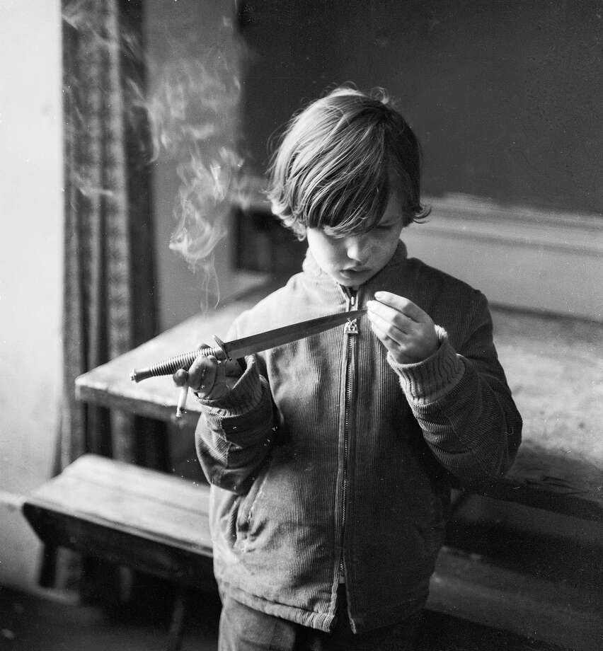 Smoking and playing with knives while being a 7-year-oldAdmittedly, this wasn't a wide-spread problem, but where are this kid's parents? Photo: Peter Hall, Getty Images / Hulton Archive