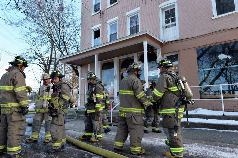 Firefighters on the scene of an apartment fire above the Kreusi Ave. Pub Wednesday morning, Jan. 8, 2014, on Lower Broadway in Schenectady, N.Y. (John Carl D'Annibale / Times Union) Photo: John Carl D'Annibale