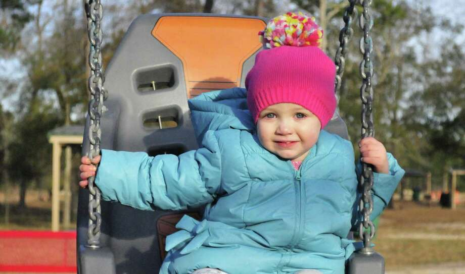 Josie Powell, 2, of Lumberton, enjoys the Lumberton City Park on F.M. 421 on Jan. 2. The city is building a sand volleyball at the new park and is considering adding a disk golf course.  Photo by Cassie Smith/@smithcassie Photo: Cassie Smith/@smithcassie