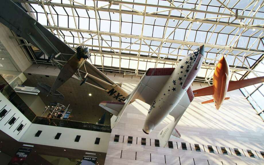 SpaceShipOne, the first privately developed spacecraft, is displayed between historic aircraft in the Smithsonian Air and Space Museum. Photo: Forrest M. Mims III / For The Express-News / ALL RIGHTS RESERVED.