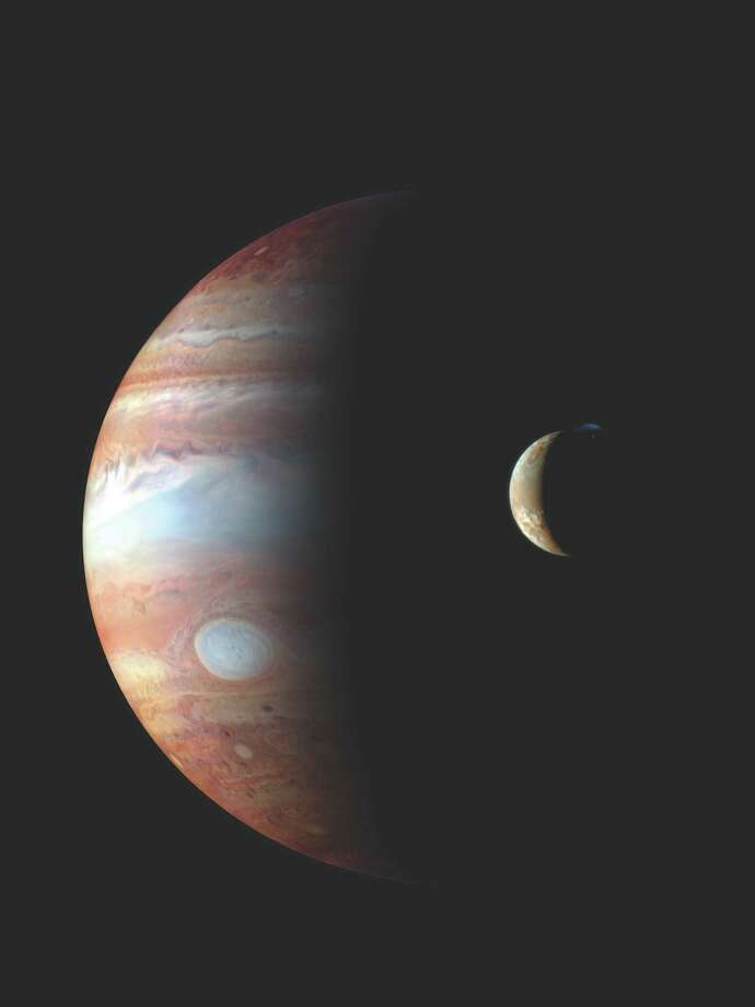 "The Houston Symphony's multimedia work ""The Planets"" includes this NASA image of Jupiter and its moon Io. Photo: JPL/NASA"