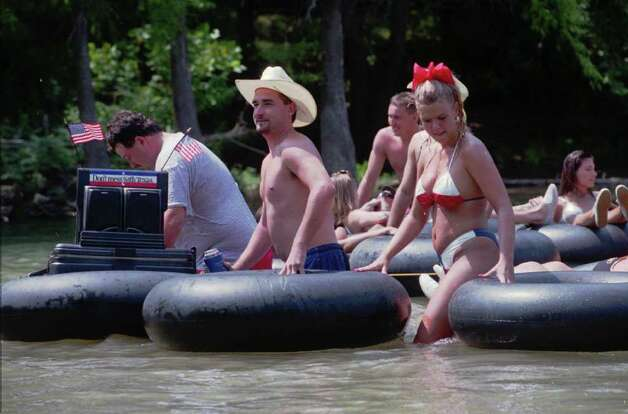 Guadalupe.   Tubers were deck out in holiday regalia on the Guadalupe above New Braunfels.  Photo by Tom Reel 9/5/98
