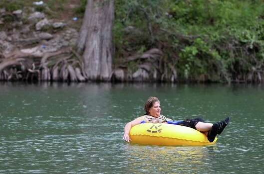 Sylvia Gonzales floats along the Guadalupe River at Camp Huaco Springs on Labor Day near New Braunfels, Texas on Monday, Sept. 6, 2010.  Kin Man Hui/kmhui@express-news.net Photo: KIN MAN HUI, SAN ANTONIO EXPRESS-NEWS / San Antonio Express-News
