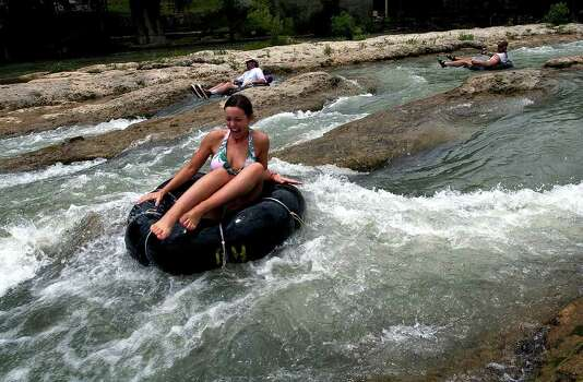 "METR O   A tuber screams as she bounces into the white water at ""The Chute"" area of the Guadalupe River near New Braunfels Monday.   TUBING ON THE GUADALUPE RIVER MAY 30, 2005  TOM REEL/STAFF Photo: TOM REEL, SAN ANTONIO EXPRESS-NEWS"