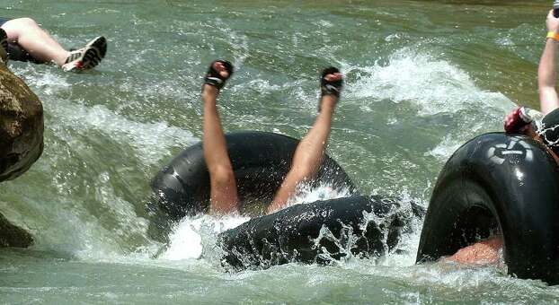 Metro daily - Tubers in various states of under water pass through Huaco (CQ) Falls during Traditional holiday tubing on the Guadalupe River in New Braunfels, Tx., Saturday, July 3, 2004.  photo bob owen Photo: BOB OWEN, SAN ANTONIO EXPRESS-NEWS / SAN ANTONIO EXPRESS-NEWS