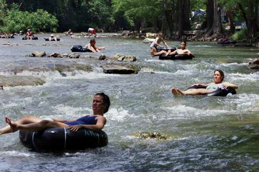 "STATE  Tubers make their way down the Guadalupe River in the ""horse shoe"" are below Canyon Lake Thursday, June 28.  The water was running just fast enough for slow tubing. Photo: TOM REEL"