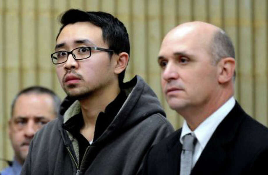 William Dong, of Stratfield Road, left, in state Superior Court the day after his arrest last Dec. 3 on multiple weapon charges, shown with Assistant Public Defender Kevin Williams. On Tuesday, federal prosecutors filed a new charge against Dong of unlawfully transporting into the state an assault weapon he purchased in Pennsylvania. Photo: File Photo / Fairfield Citizen