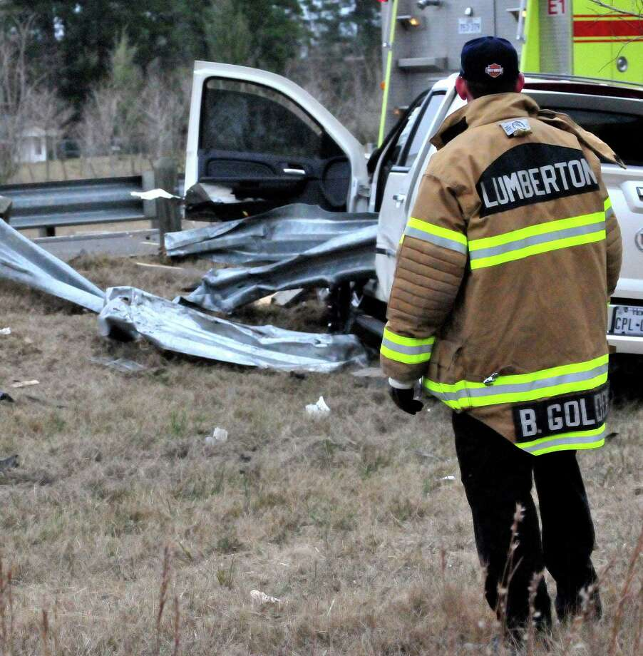 A Jasper woman was taken to the hospital after she dodged debris on a Lumberton road and hit a guardrail. Photo by Cassie Smith/@smithcassie. Jan. 8, 2014. Photo: Cassie Smith
