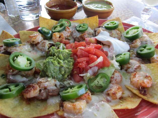 Cafe Adobe offers shrimp nachos and other Mexican food fare in Houston. Photo: Syd Kearney, Houston Chronicle