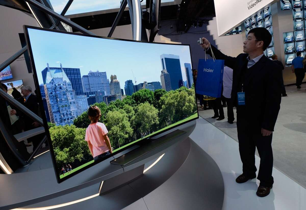 A Samsung curved OLED television is on display at the Samsung booth at the 2014 International CES.