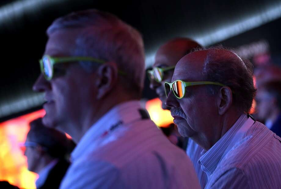 Attendees watch a 3D presentation at the LG booth at the 2014 International CES. Photo: Getty Images