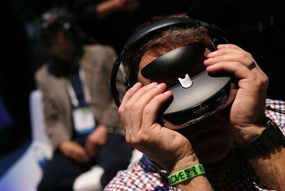 Attendees wear Sony video gaming goggles in the Sony booth at the 2014 International CES. Photo: Getty Images