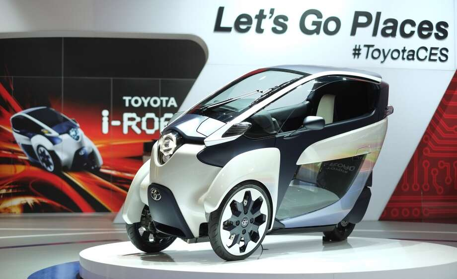 Toyota shows their Toyota I-Road concept during the 2014 International CES. Photo: AFP/Getty Images