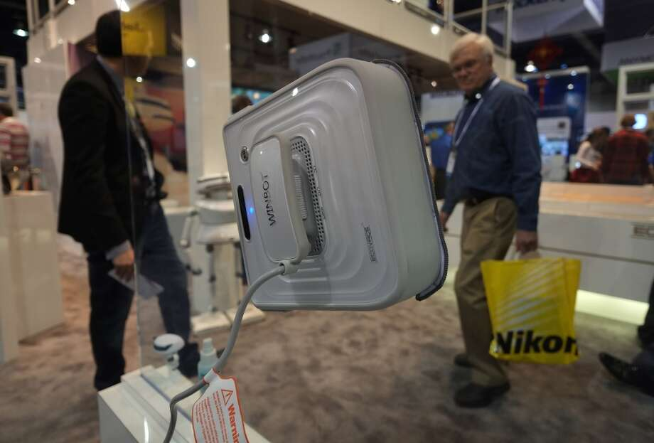 Ecovacs presents Winbot , a window cleaner robot, during the 2014 International CES. Photo: AFP/Getty Images