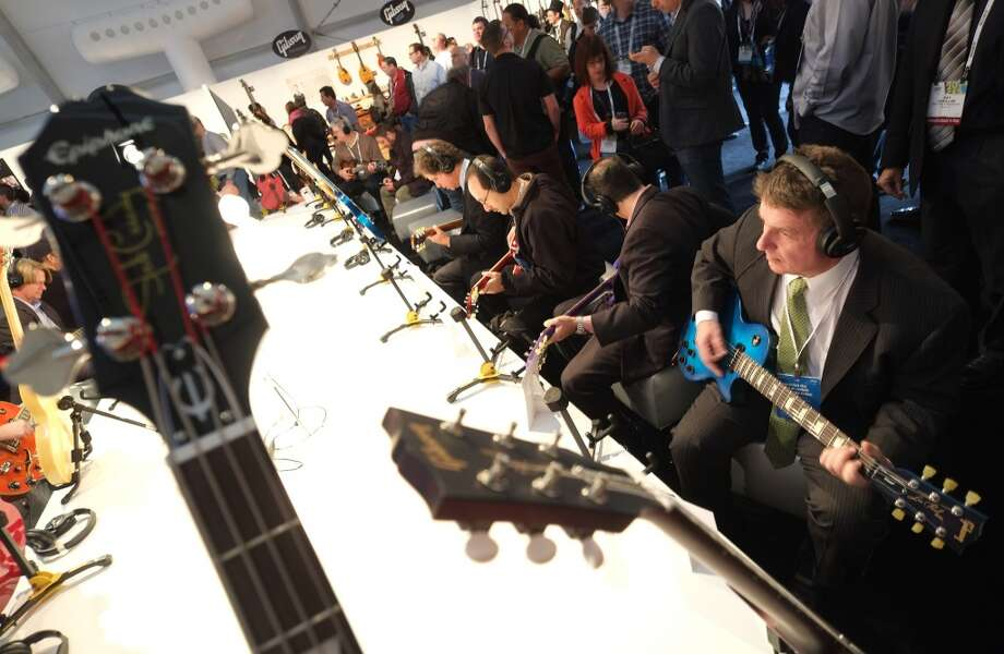 Visitors check Gibson's guitars during the 2014 International CES at the Las Vegas Convention Center. Photo: AFP/Getty Images