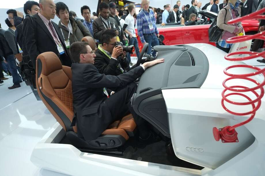Visitors check Audi's Virtual cockpit during the 2014 International CES at the Las Vegas Convention Center. Photo: AFP/Getty Images