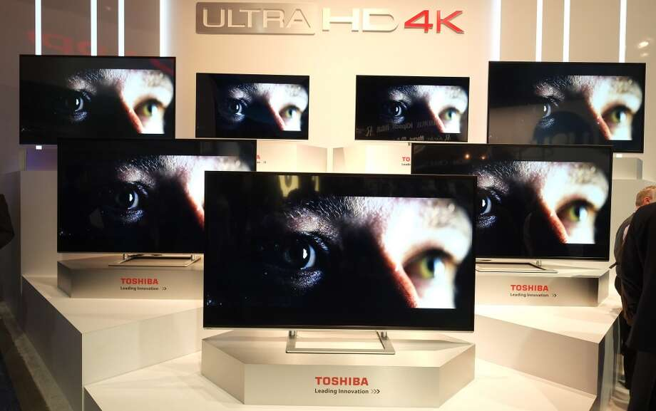 Toshiba's 4K UHD TVs are seen during the 2014 International CES at the Las Vegas Convention Center on January 7, 2014 in Las Vegas. Photo: AFP/Getty Images
