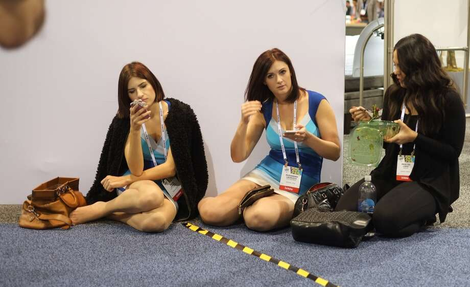 Participants take a short rest during the 2014 International CES at the Las Vegas Convention Center on January 7, 2014 in Las Vegas. Photo: AFP/Getty Images