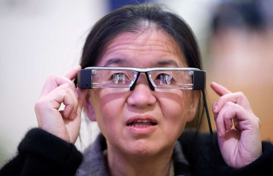 An attendee tries the Epson Moverio BT-200 smart glasses, at the 2014 International CES. Photo: AFP/Getty Images