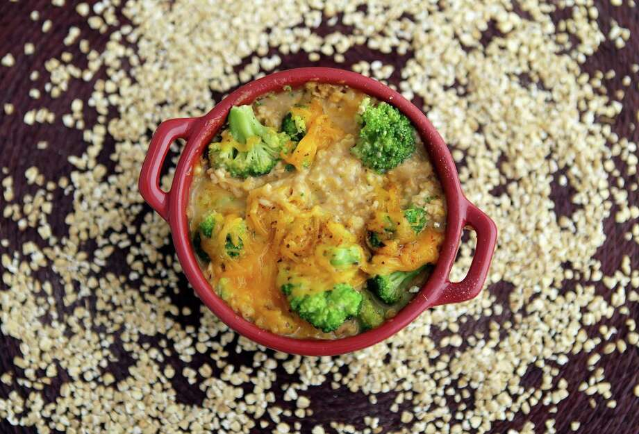 The secret savory side of oatmeal will enhance this recipe for Broccoli-Cheddar Oven Risotto. (Stephanie S. Cordle/St. Louis Post-Dispatch/MCT) ORG XMIT: 1147049 Photo: Stephanie S. Cordle / St. Louis Post-Dispatch