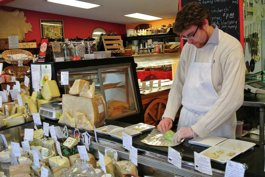 Eric Paul's shop, The Cheese Traveler in Albany, stocks 100 to 120 cheeses, some for those who are willing to forgo budgets for some good cheese. (Deanna Fox)