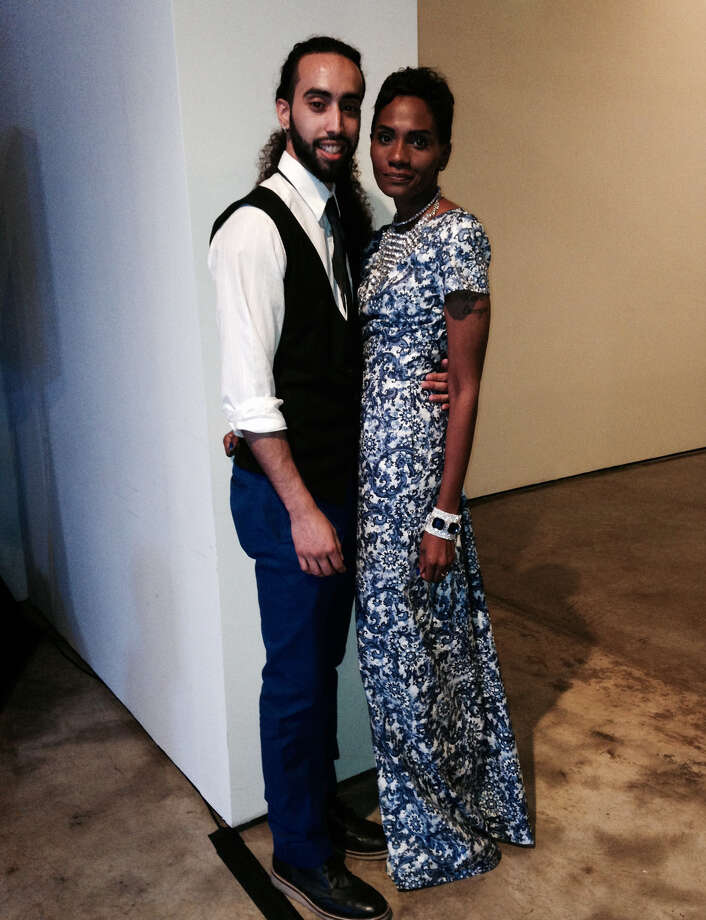 Gabriel Sayan and Jacqueline Snowden make a striking, chic couple in matching blues: Snowden in a stunning blue toile long dress she sewed herself, and Sayan in slim, blue trousers teamed with a tie and vest on top. Snowden accessorized her look with a statement necklace and elastic bracelets — one in blue — she layered on top of the other. - Michael Quintanilla Photo: Photos By Michael Quintanilla / San Antonio Express-News / San Antonio Express-News