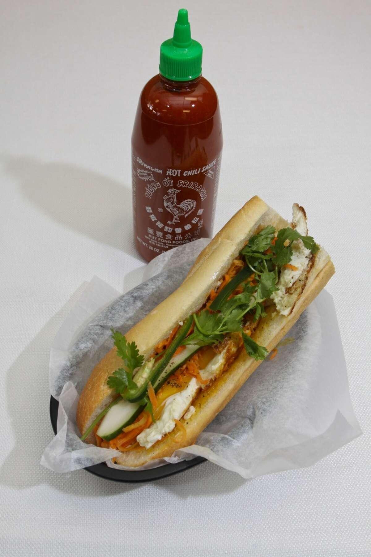 Egg sandwich and Sriracha sauce at Cafe TH