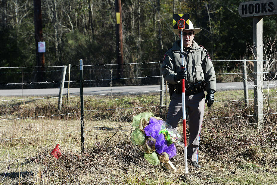State Trooper Calvin Starkie surveys the crash site where two teenagers from Kountze were killed in a two-vehicle accident just before 5 p.m. Friday on Highway 69. Michael Rivera/@michaelrivera88   Photo Taken 01/07/14 Michael Rivera/@michaelrivera88