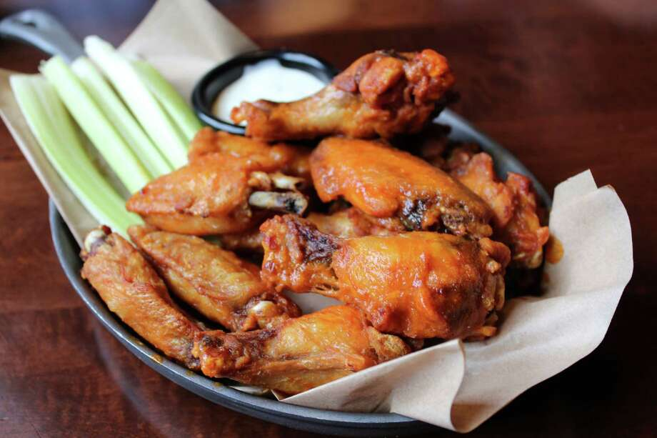 Tavern wings at Brick House Tavern + Tap can be ordered with a choice of four sauces. Photo: Jennifer McInnis