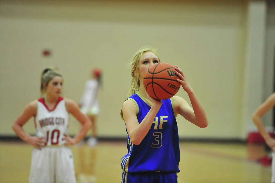 Hamshire-Fannett's Becca Dlord, No. 3, shoots a free point shot during Tuesday's game against Bridge City girls at Bridge City High School. The final score was Hamshire-Fannett 56, Bridge City 45. Michael Rivera/@michaelrivera88  Photo taken Tuesday, 01/07/14