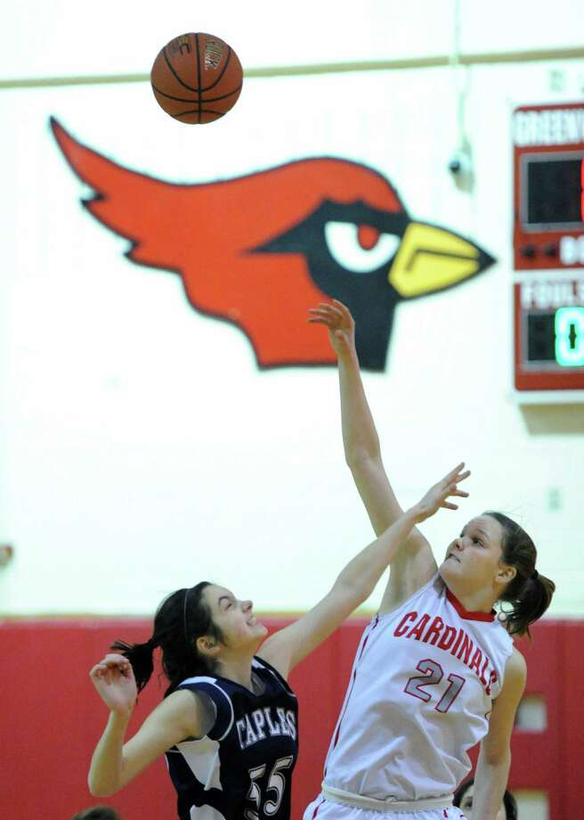 (7) Abbie Wolf (#21). The sophomore sensation from Greenwich has really  come into her own this  season, dominating the paint with her strong  inside game. In a 71-50  win over Darien earlier this season, Wolf  scored 23 points and grabbied  19 rebounds. Photo: Bob Luckey / Greenwich Time