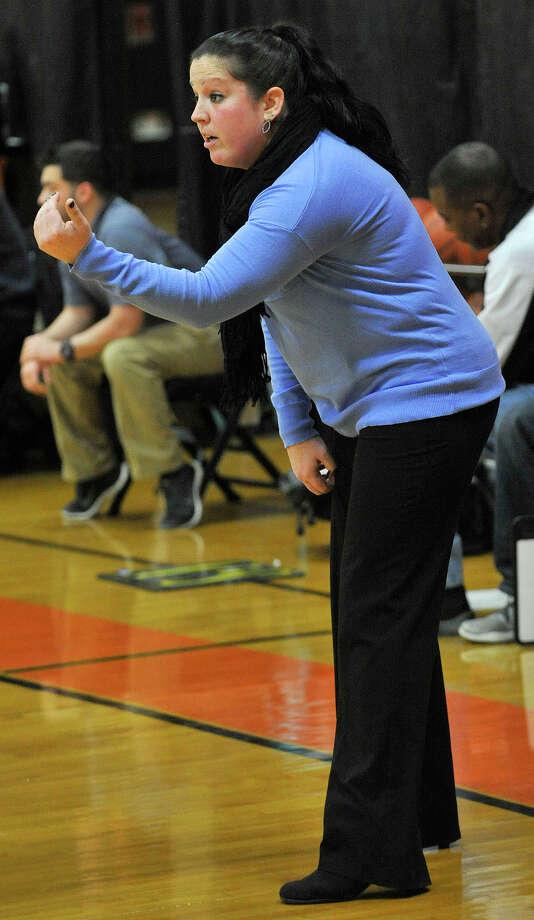 Stamford girls basketball head coach Diane Burns talks to her team during their game against St. Joseph at Stamford High School in Stamford, Conn., on Tuesday, Jan. 7, 2014. Stamford won, 59-40. Photo: Jason Rearick / Stamford Advocate