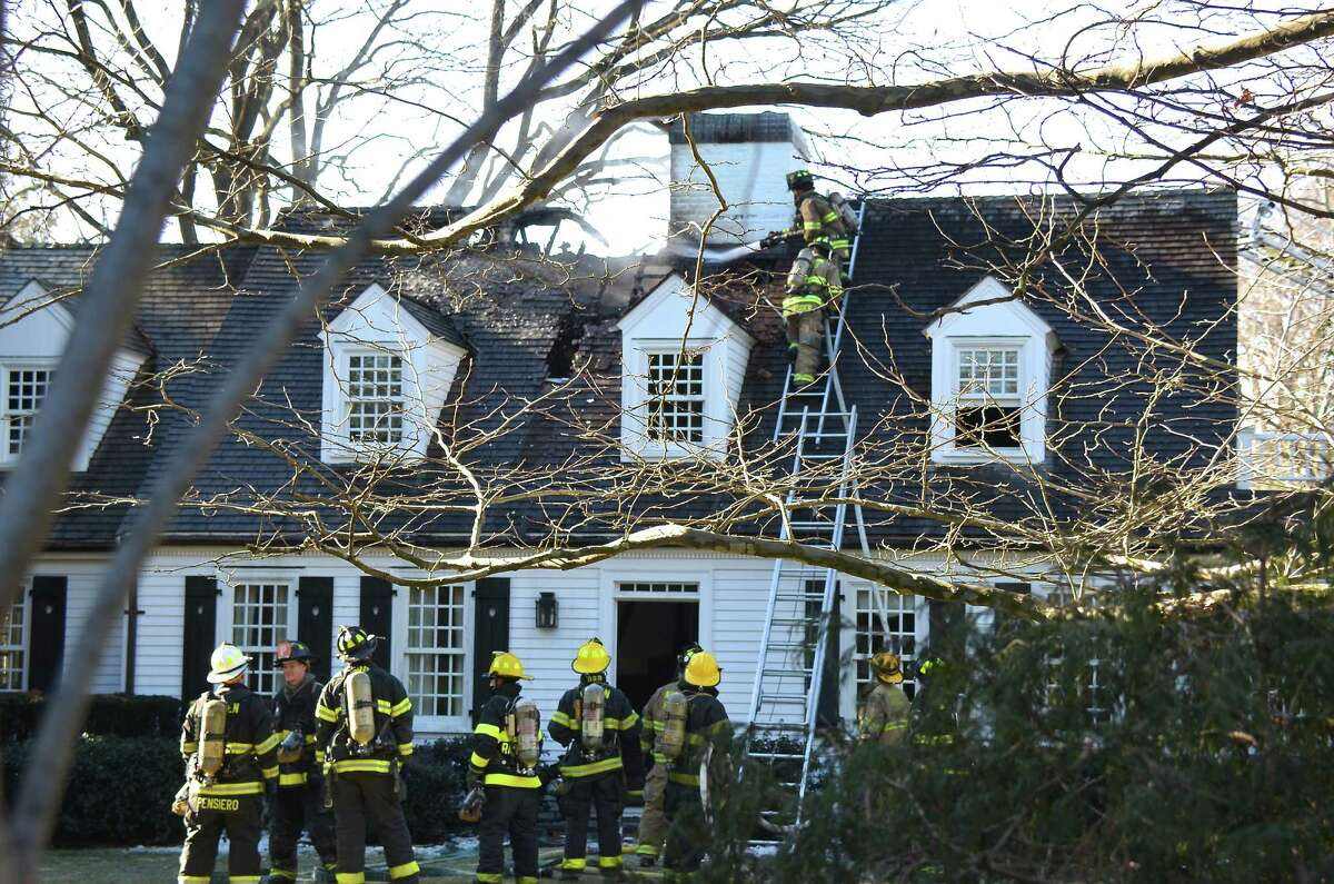 Darien and Noroton Heights firefighters responded to a structure fire at 261 Hollow Tree RIdge Road on Wednesday, Jan 8, 2014, in Darien, Conn.
