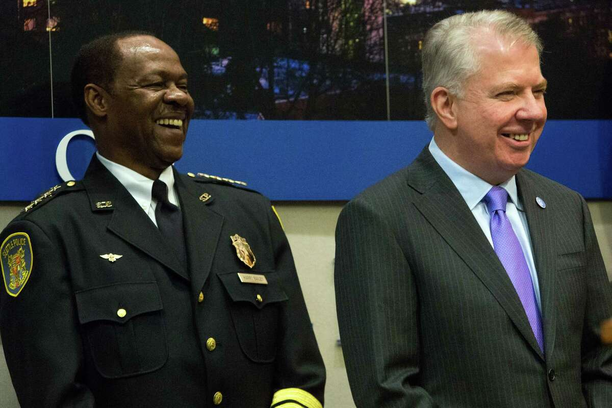 Newly appointed interim Seattle Police Chief Henry Bailey and Seattle Mayor Ed Murray share a light moment after Murray announced the appointment on Wednesday, January 8, 2014 at City Hall.