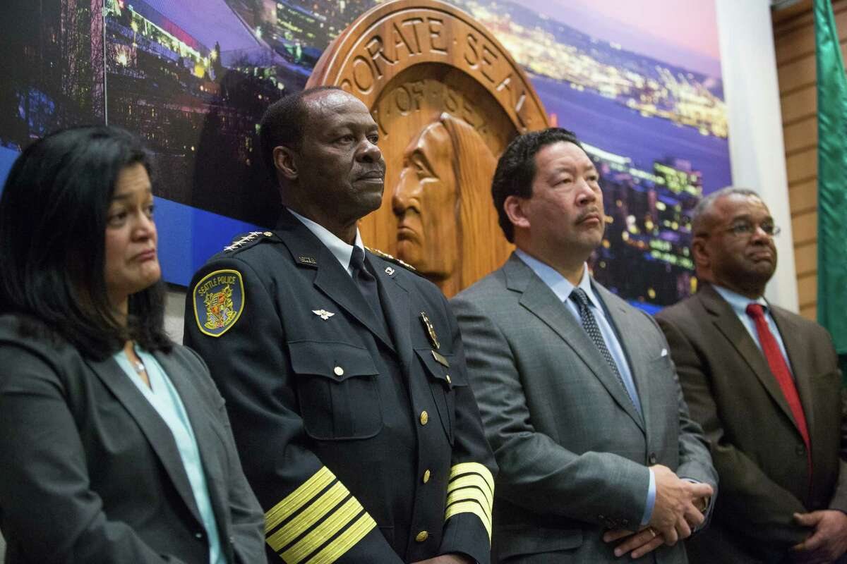 From left, Pramila Jayapal, interim Seattle Police Chief Henry Bailey, City Councilman Bruce Harrell and Ron Sims listen as Seattle Mayor Ed Murray announces the appointment of Bailey on Jan. 8, 2014 at City Hall.