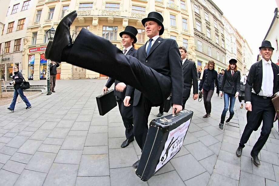 Cheeky Czechs:Monty Python fans show off their goofy gaits during International Silly Walk Day in Brno, Czech Republic. Photo: Radek Mica, AFP/Getty Images