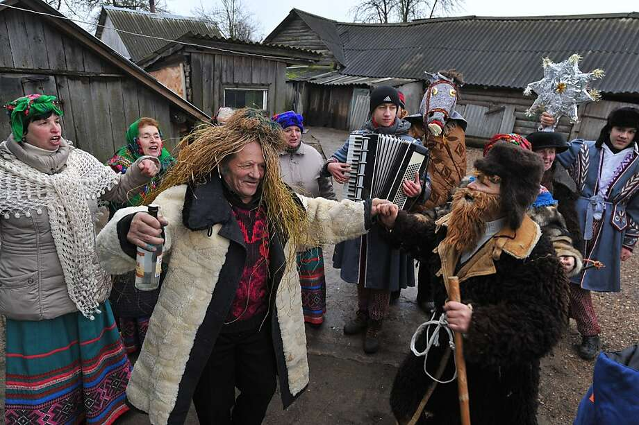 With wild wigs, fake beards, accordion music and vodka,Belarusians mark Koliady, an ancient pagan holiday initially observed on the winter solstice but since appropriated to celebrate the Julian-calendar Christmas. These revelers were partying in the village of Napalki, some 40 miles north of Minsk. Photo: Viktor Drachev, AFP/Getty Images