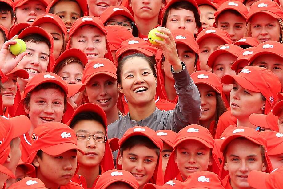 Li Na and her many retrievers:Some of the Australian Open's 380 ball kids swarm China's Li Na in Melbourne ahead of the first major tennis tournament of the year. Photo: Michael Dodge, Getty Images