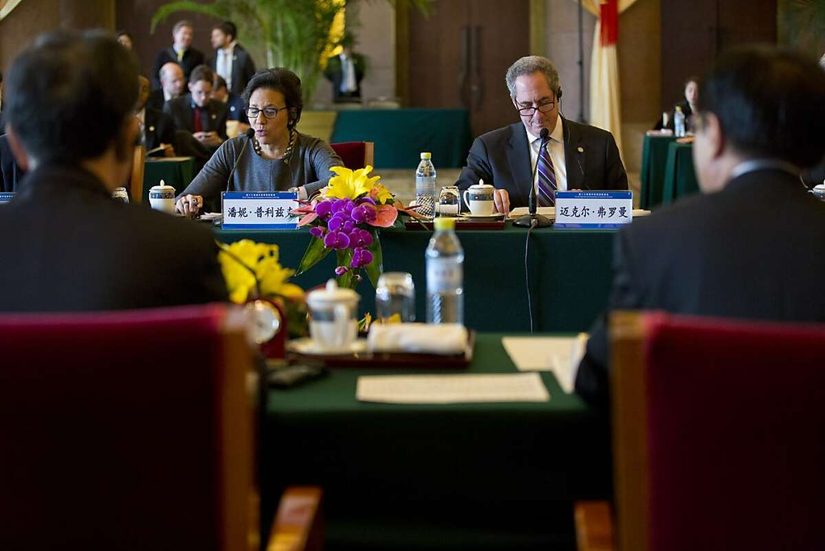 U.S. Secretary of Commerce Penny Pritzker (centre L) and US Trade Representative Michael Froman (centre R) attend the opening meeting session of the 24th China-U.S. Joint Commission on Commerce and Trade held at Diaoyutai State Guesthouse in Beijing on December 20, 2013. Chinese Vice Premier Wang Yang and Chinese Commerce Minister Gao Hucheng are seated front left and front right. AFP Photo/Alexander F. Yuan/ PoolAlexander F. Yuan/AFP/Getty Images