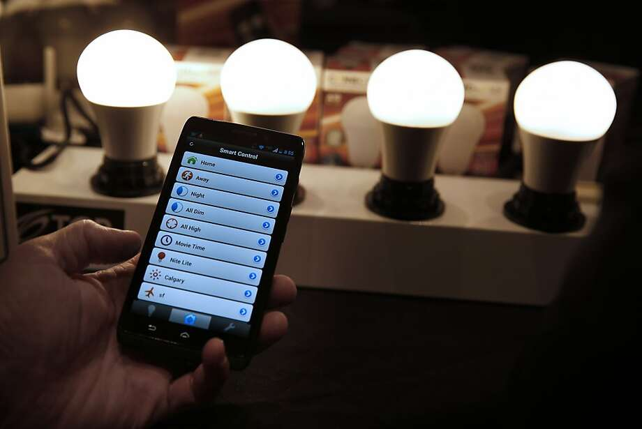 A Consumer Electronics Show exhibitor shows off the smartphone-operated Connected lighting system by TCP. Photo: Patrick T. Fallon, Bloomberg