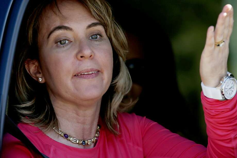 Gabrielle Giffords waves to well-wishers after skydiving to mark the third anniversary of the shooting that injured her and 12 others and killed six. Photo: Ross D. Franklin, Associated Press