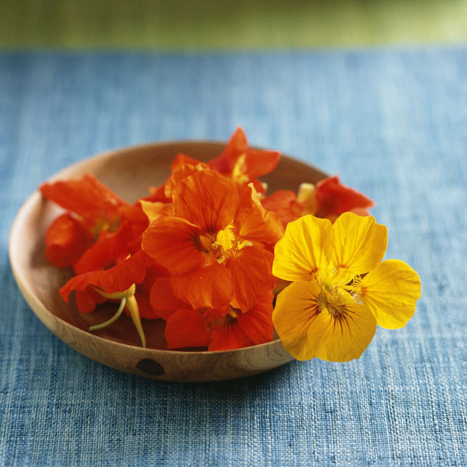 OUT: Edible flowers.  Photo: Kristin Duvall, Getty Images / (c) Kristin Duvall