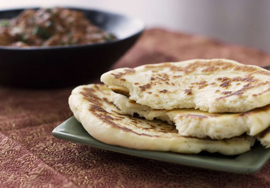 "GOING OUT: Flatbreads. How can something as innocuous as pita and naan be ""out""? Flatbreads were trendy in 2009, and have lost their edge. But nearly half of chefs still rated them as popular.  Photo: Yogi Studio, Getty Images / Flickr RF"