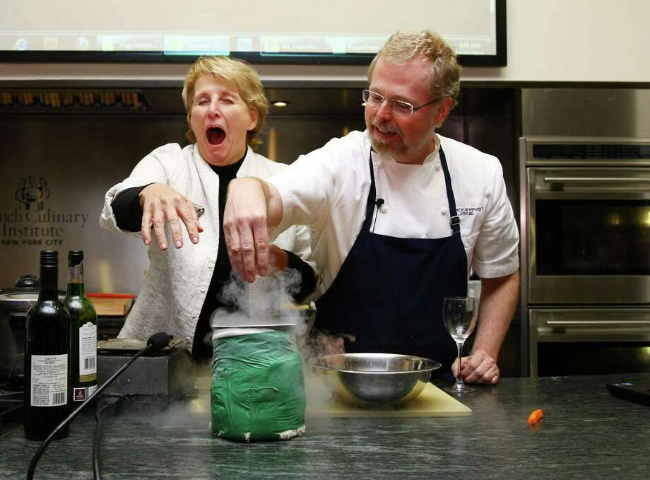 "OUT: Molecular gastronomy, or the science of changing the taste and texture of food. Cocktail ice spheres, anyone? So niche it was never ""in,"" except with Nathan Myhrvold, Microsoft's former chief tech officer and author of the molecular gastronomy tome ""Modernist Cuisine."" Myhrvold, right, is pictured in 2011.  Photo: Neilson Barnard, Getty Images / 2011 Getty Images"