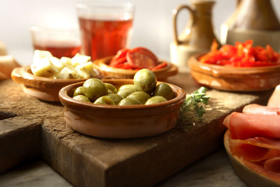 GOING OUT: Tapas. Small Spanish plates – along with dim sum and Meze (small Middle Eastern plates) – are losing their cool, according to the restaurant survey.  Photo: Floortje, Getty Images / Vetta