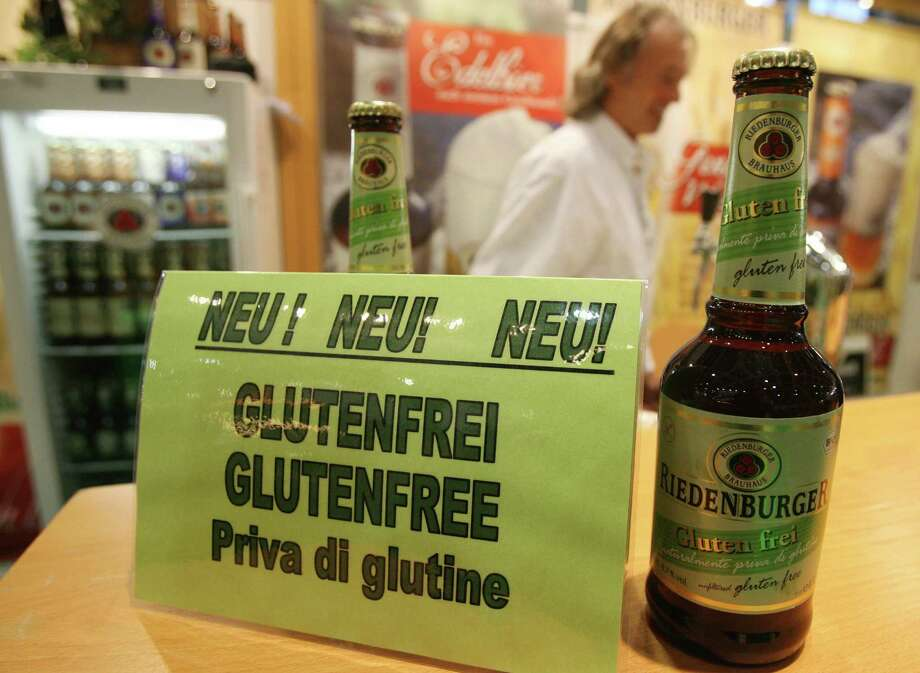 "IN: Gluten-free everything. More than 75 percent of chefs said gluten-free cuisine, including beer, pictured in Germany, is ""hot.""  Photo: JOHN MACDOUGALL, Getty Images / 2008 AFP"