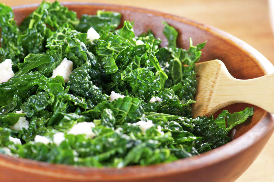 "IN: Kale. This trendy green is here to stay, with more than 60 percent of chefs saying dark greens and kale salads in particular are ""hot.""  Photo: Poppy Barach, Getty Images / (c) Poppy Barach"