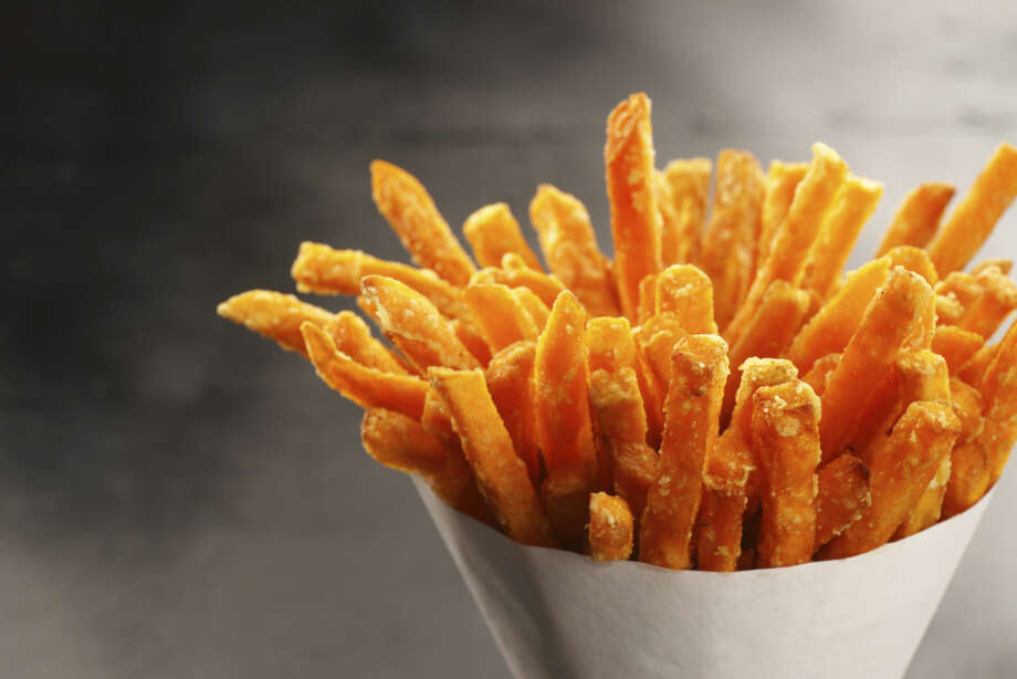 "OUT: Sweet potato fries. They're still on every burger menu, where they somehow feel healthier than regular fries. But 49 percent of chefs say they're ""yesterday's news."" Photo: TheCrimsonMonkey, Getty Images / (c) TheCrimsonMonkey"